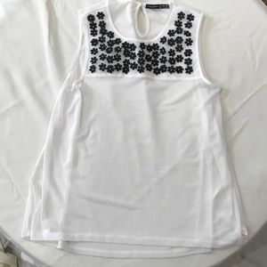 Sheer white camisole tank with black flowers